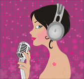 Beautiful girl in music royalty free stock photography