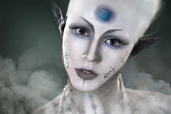 Beautiful girl with the mysterious make-up Alien Stock Photos