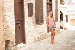 Beautiful girl in the narrow street Royalty Free Stock Photo