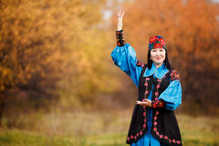 Beautiful girl in national dress smartly blue with royalty free stock photos