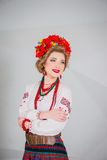 A beautiful girl in National Ukrainian Costume. captured in studio. Embroidery and jacket. wreath. circlet of flowers. red lips. A beautiful girl in National Royalty Free Stock Photo
