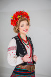 A beautiful girl in National Ukrainian Costume. captured in studio. Embroidery and jacket. wreath. circlet of flowers. red lips. A beautiful girl in National Royalty Free Stock Photos