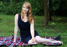 Redhead in the park royalty free stock photography