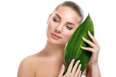 Beautiful girl, nature beauty. Beautiful girl posing with green leaf, nature beauty stock images