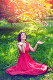 Beautiful girl on the nature in the park. Against the background Royalty Free Stock Photography