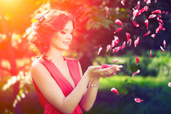 Beautiful girl on the nature in the park. Against the background Royalty Free Stock Image