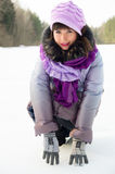 A beautiful girl on the nature in the winter in the snow Royalty Free Stock Image