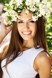 Beautiful girl on the nature in wreath of flowers Royalty Free Stock Images