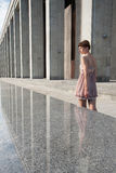 Beautiful girl near the building. Beautiful young woman near the building Royalty Free Stock Photography