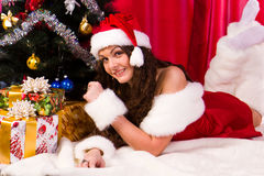 Beautiful girl near christmas tree Royalty Free Stock Photography