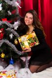 Beautiful girl near christmas tree Stock Image