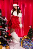 Beautiful girl near christmas tree Royalty Free Stock Photos