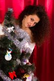 Beautiful girl near christmas tree Stock Images