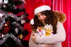 Beautiful girl near christmas tree Royalty Free Stock Photo