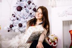 Beautiful girl near christmas tree Royalty Free Stock Images