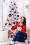 Beautiful girl near christmas tree Stock Photo