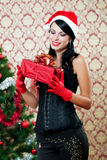 Beautiful girl near a christmas tree Royalty Free Stock Images