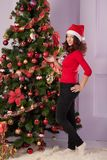Beautiful girl near Christmas tree Stock Image