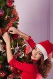 Beautiful girl near Christmas tree Royalty Free Stock Image