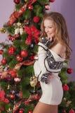 Beautiful girl near Christmas tree Stock Images