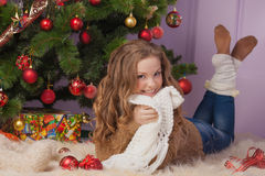 Beautiful girl near Christmas tree Royalty Free Stock Photography