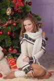 Beautiful girl near Christmas tree Stock Photos