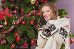 Beautiful girl near Christmas tree Royalty Free Stock Photos