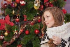Beautiful girl near Christmas tree Royalty Free Stock Photo