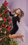 Beautiful girl near Christmas tree Stock Photography