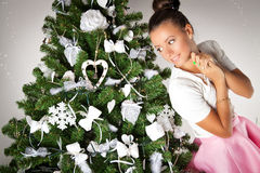 Beautiful girl near the Christmas tree Stock Images