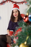 Beautiful girl near the Christmas tree Stock Photos