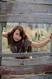 Beautiful girl near the fence Royalty Free Stock Photo