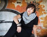 A beautiful girl near a graffiti wall Royalty Free Stock Images