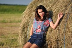 Beautiful girl near haystacks Stock Photos
