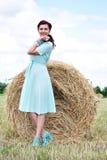 Beautiful girl near haystacks Royalty Free Stock Photos