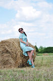 Beautiful girl near haystacks Stock Images