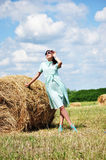 Beautiful girl near haystacks Stock Photos