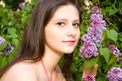 Beautiful girl near the lilacs Stock Photo