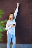 Beautiful girl near maroon wall with cup coffee Royalty Free Stock Photography