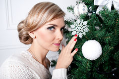 The beautiful girl near a New Year tree Stock Photo