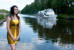 Beautiful girl near the river Royalty Free Stock Photos