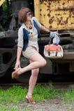 The beautiful girl near a rusty railway car Royalty Free Stock Image