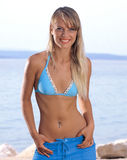 Beautiful girl near the sea. Beautiful girl in swimsuit near the sea Stock Photo