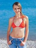 Beautiful girl near the sea. Beautiful girl in swimsuit near the sea Royalty Free Stock Photos