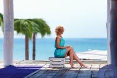 Beautiful girl near the seaside Royalty Free Stock Image