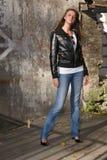 Beautiful girl near stone wall Stock Image