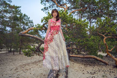 Beautiful girl near a tree on the sand, Olkhon island. Baikal stock photos