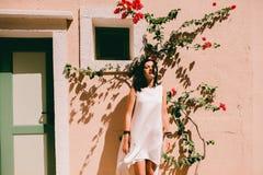Beautiful girl near the wall. Beautiful girl in a white dress near the wall Royalty Free Stock Photo