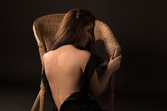 Beautiful girl. Near the wicker chair Stock Images