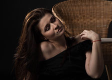 Beautiful girl. Near the wicker chair royalty free stock image
